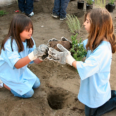 Two students participate in a joint BCR/L.A. County Earth Day planting event.