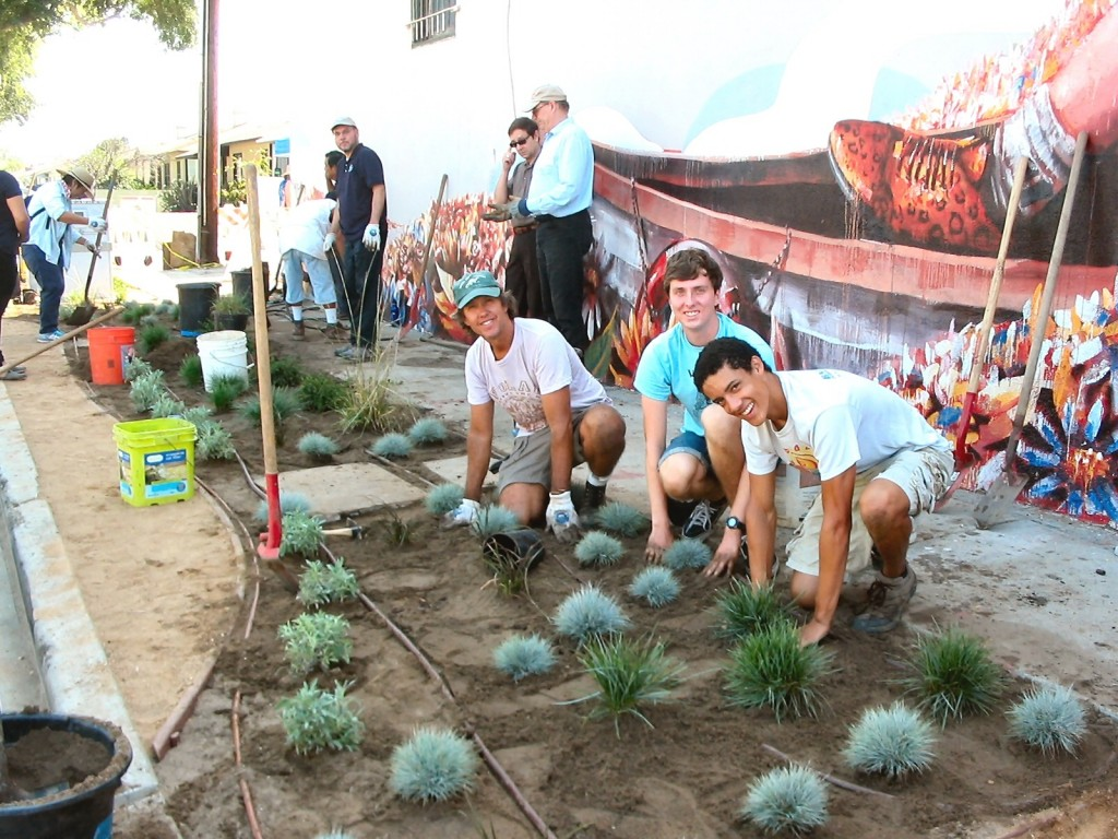 Foreground, L to R: Steve Williams (in green cap), Surfrider Ocean-Friendly Gardens Program Captain; Chris Goodwin and Evan Dumas, Culver City High School BCR Club members and 2015 graduates planting sustainable native plants.