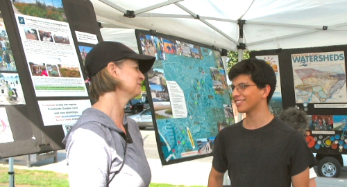 Erick Perez explains Ballona Creek to a visitor to the BCR booth at Del Rey Day.